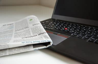 news paper and laptop