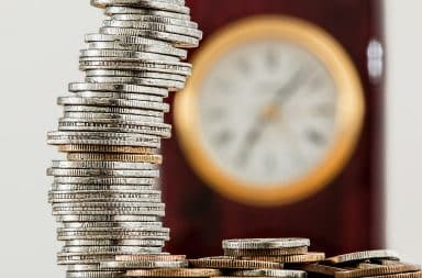 Stack of coins and a clock