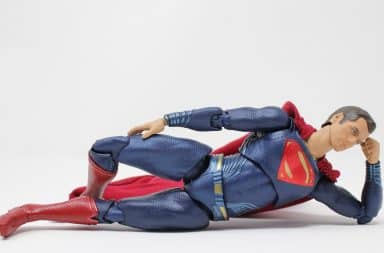 Superman lying down casually