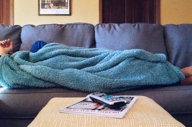 lazy on the couch under a blanket