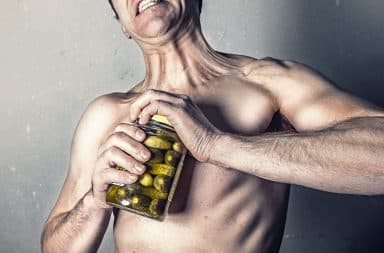 Strong man opening pickles