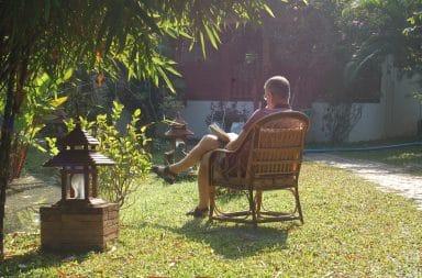 guy sitting in yard