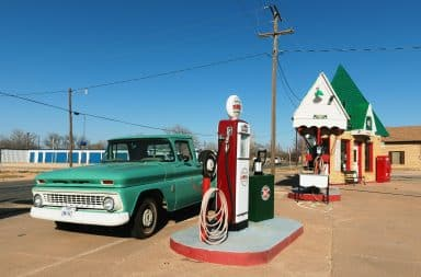 Antique truck at a gas station